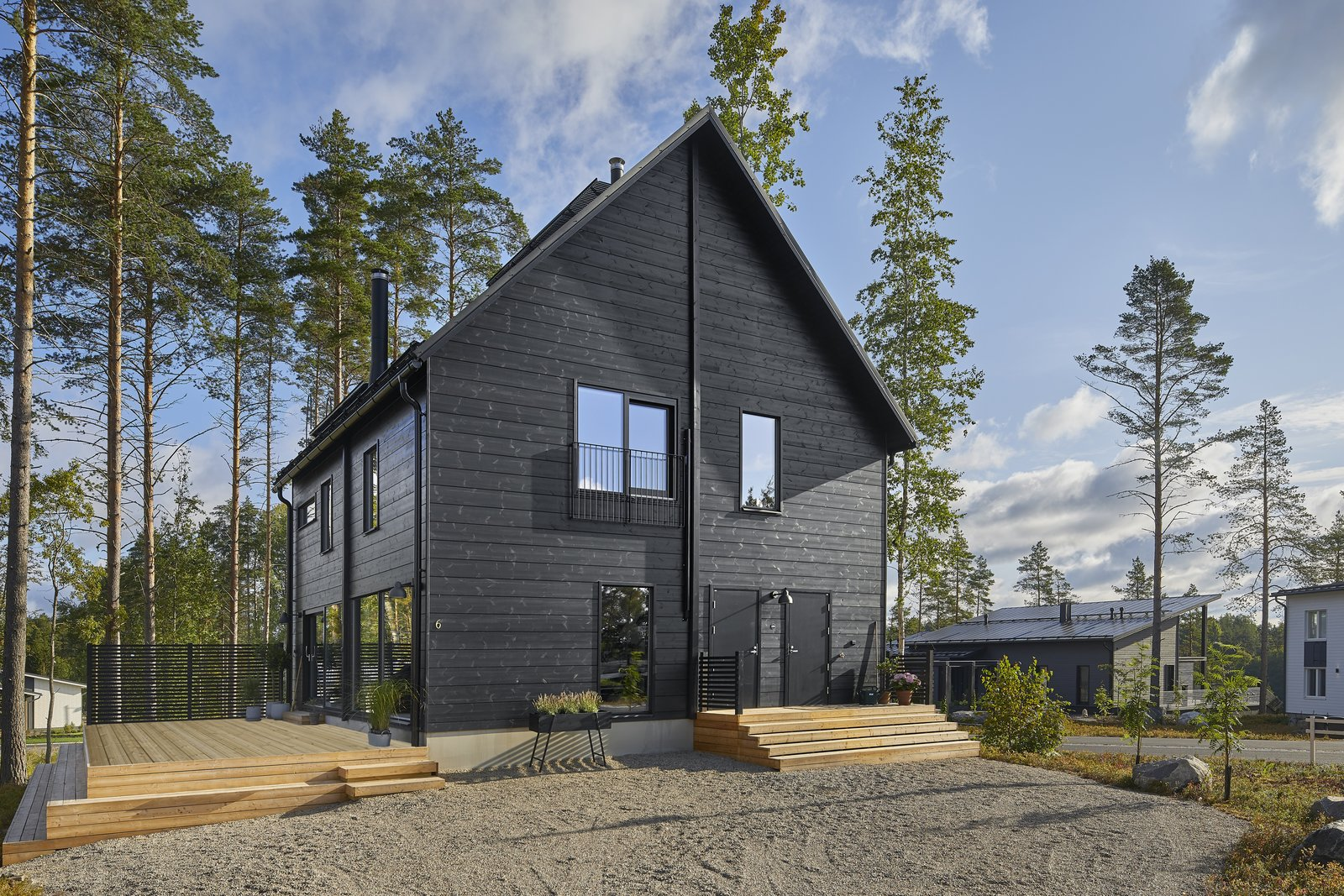 This house has a sauna and four bedrooms, including a master bedroom on the second level that looks down onto the lake.