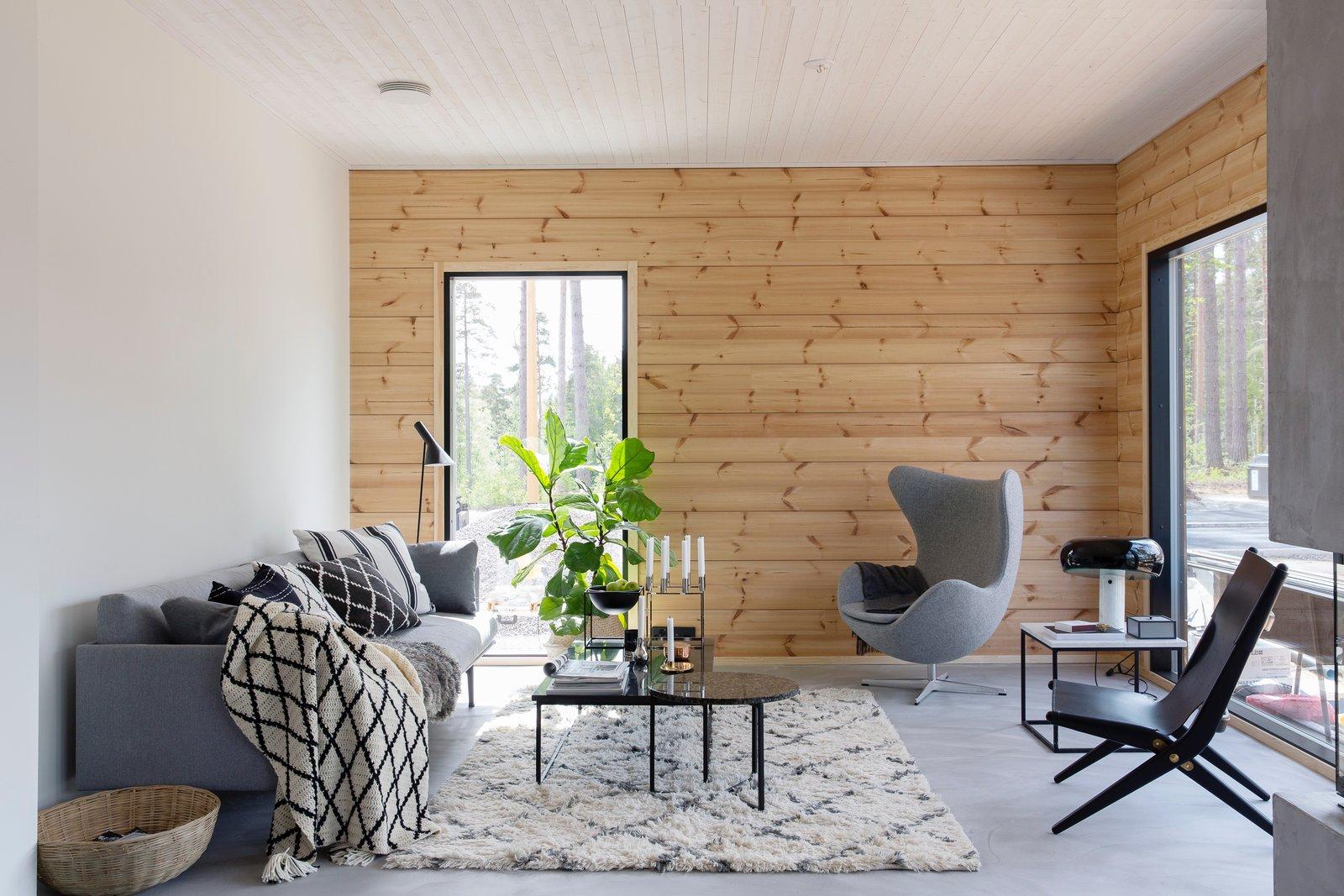 The living room of Ink, a Honka Fusion home furnished by interior designer Jonna Kivilahti.