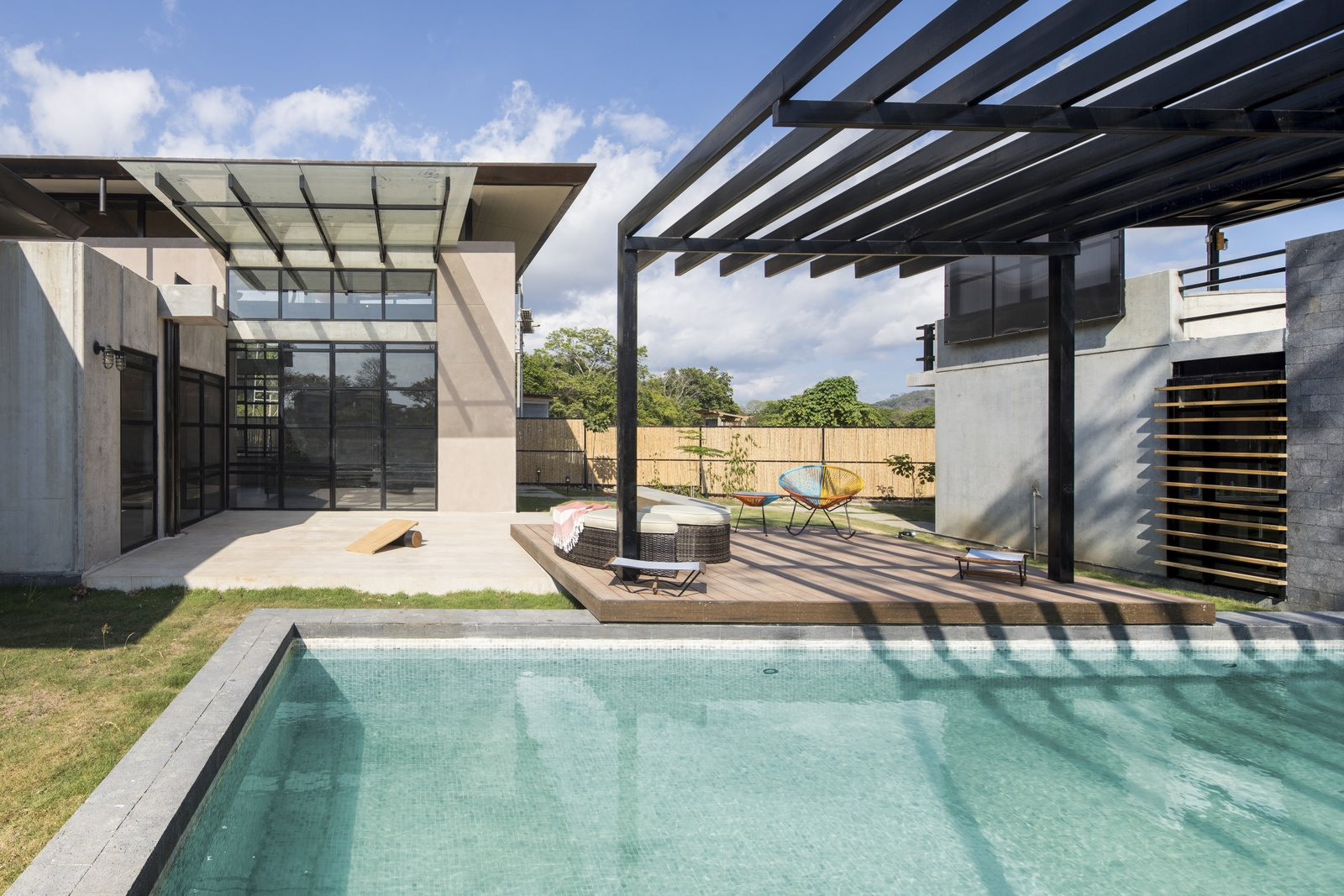 The layout of the three buildings creates a private garden space within the site.