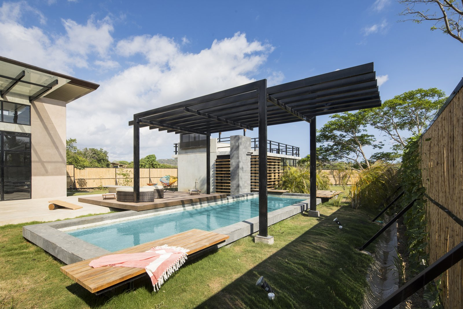 A pergola keeps swimmers cool on hot days.