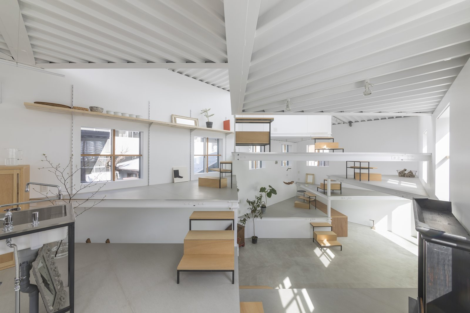 13 Spiraling Platforms Increase Space And Connection In This One Room Home