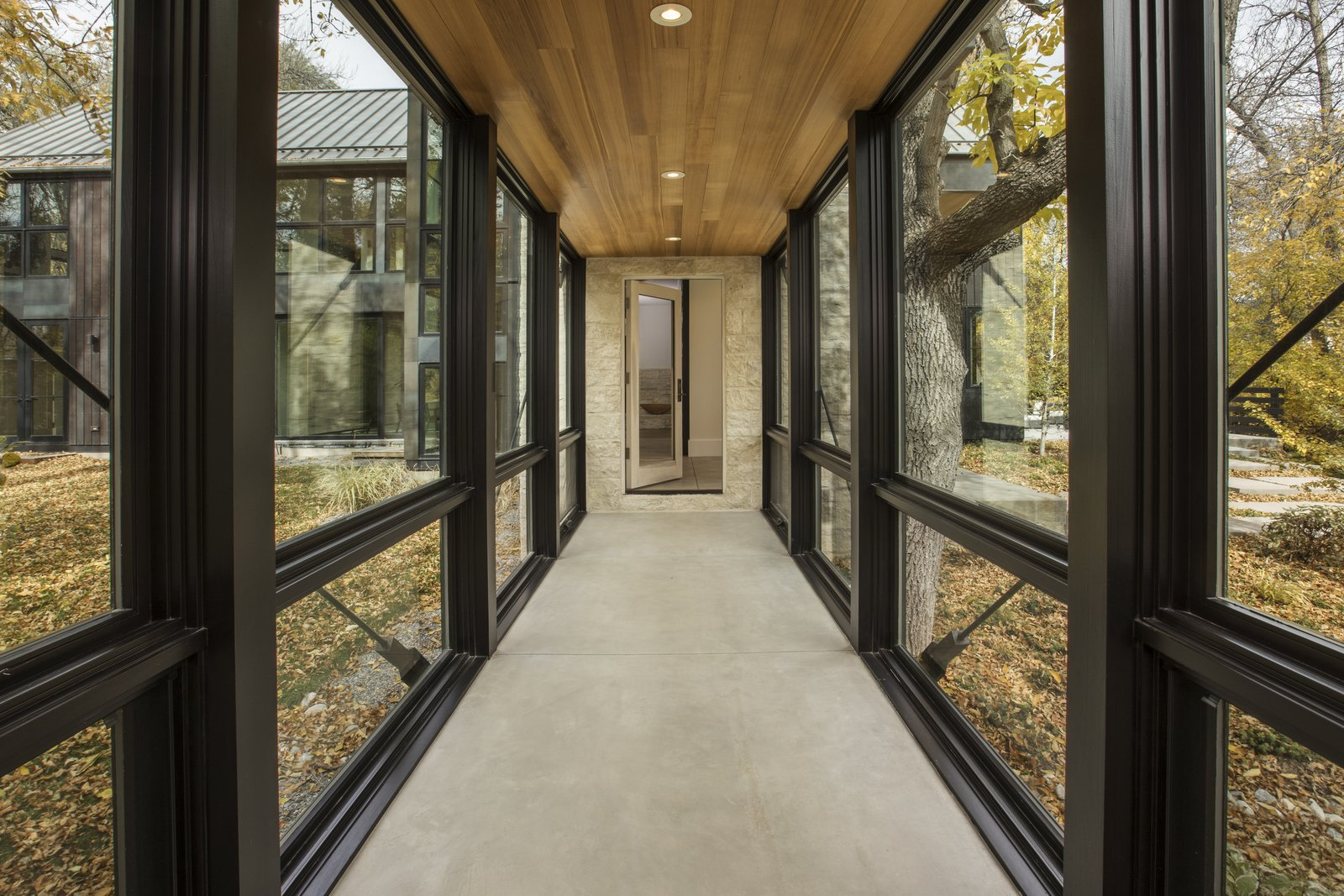 A fully glazed corridor allows the owner to enjoy the autumn foliage outdoors.