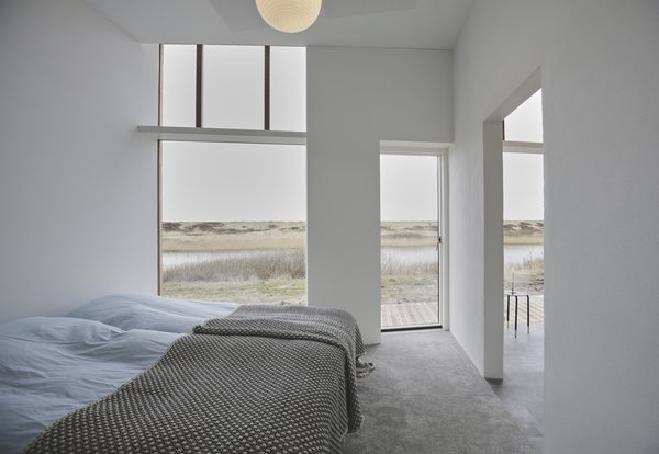 The lake-facing outdoor terrace can be accessed through the bedroom.