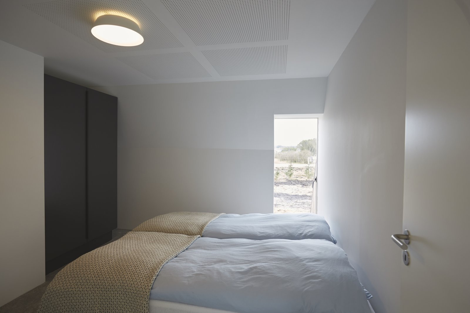 The comfy bedrooms are simply furnished.