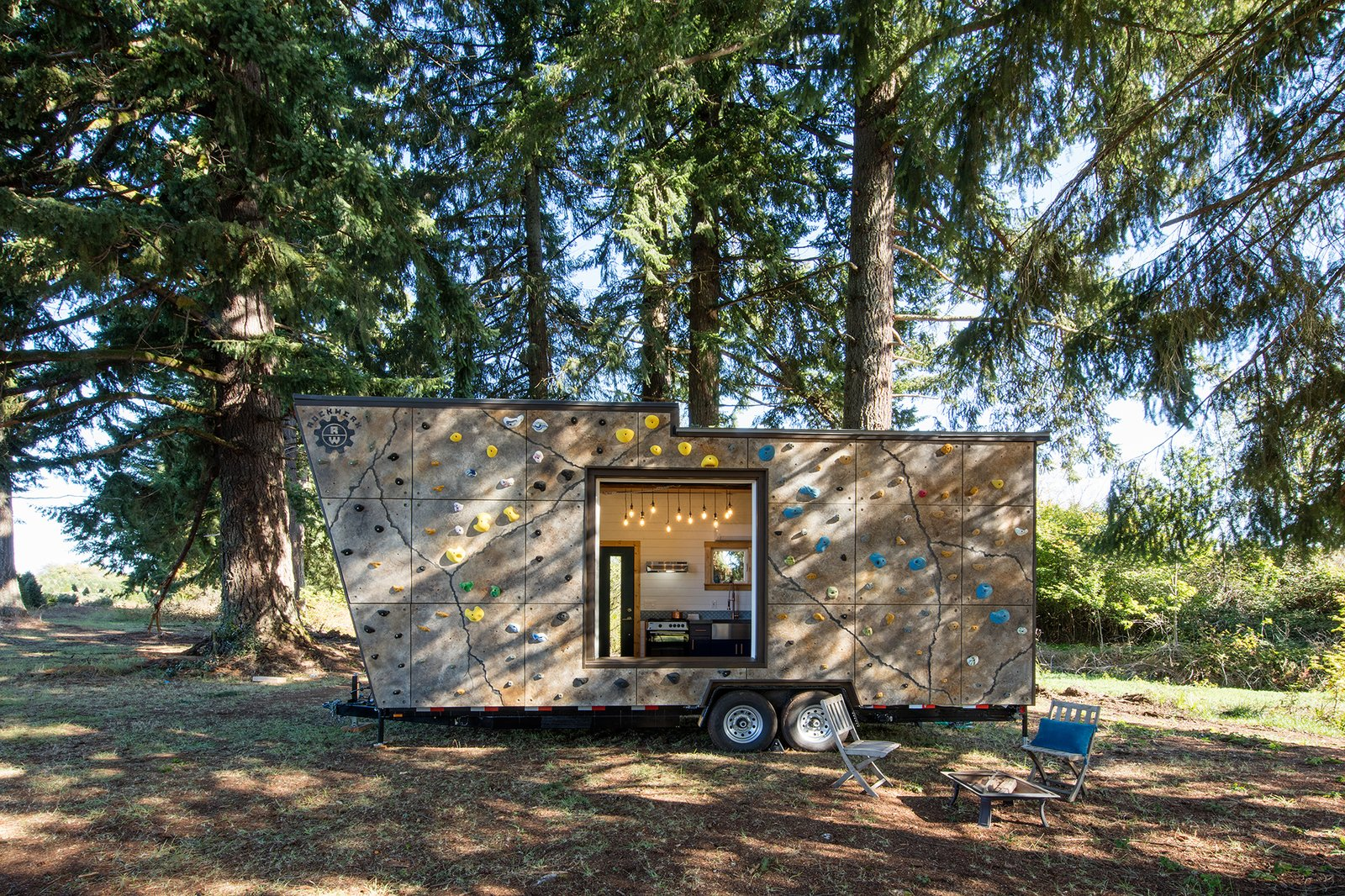 A custom rock wall system that takes care of the couple's shared passion for bouldering.