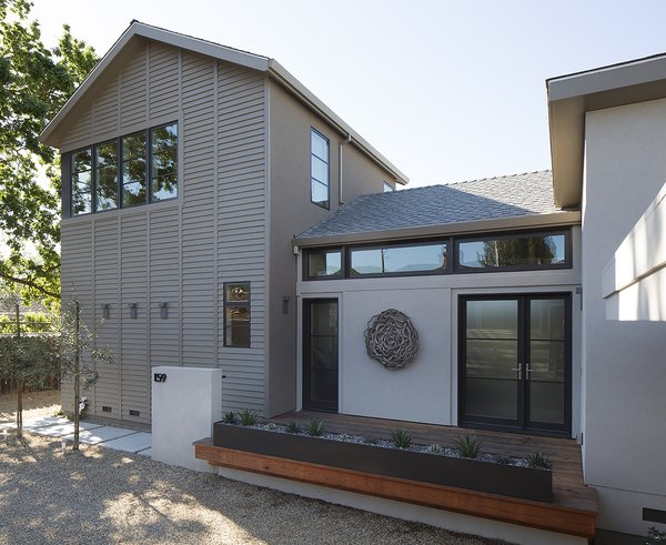 Modern home with outdoor, front yard, small patio, porch, deck, trees, and wood patio, porch, deck. Entry Photo 2 of Downtown Sonoma Residence