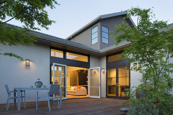Modern home with back yard, trees, wood patio, porch, deck, doors, exterior, wood, and swing door type. From the rear patio Photo 3 of Downtown Sonoma Residence