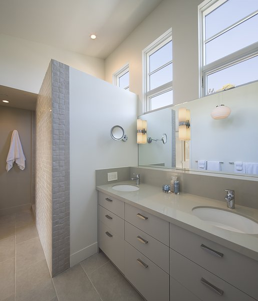 Modern home with bath room, engineered quartz counter, porcelain tile floor, drop in sink, wall lighting, porcelain tile wall, open shower, and ceiling lighting. The master bath with natural light yet complete privacy Photo 4 of Downtown Sonoma Residence