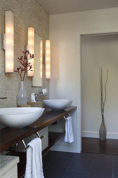 Modern home with bath room, wood counter, porcelain tile floor, mosaic tile wall, wall lighting, and vessel sink. Master Bath with live edge counter Photo 8 of Healdsburg Makeover