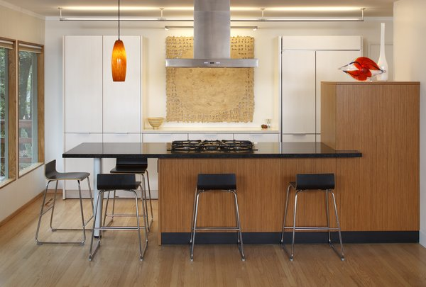 Modern home with kitchen, engineered quartz counter, wood cabinet, white cabinet, refrigerator, medium hardwood floor, and ceiling lighting. A kitchen designed to be backdrop to the great room Photo  of Sonoma Modern Kitchen
