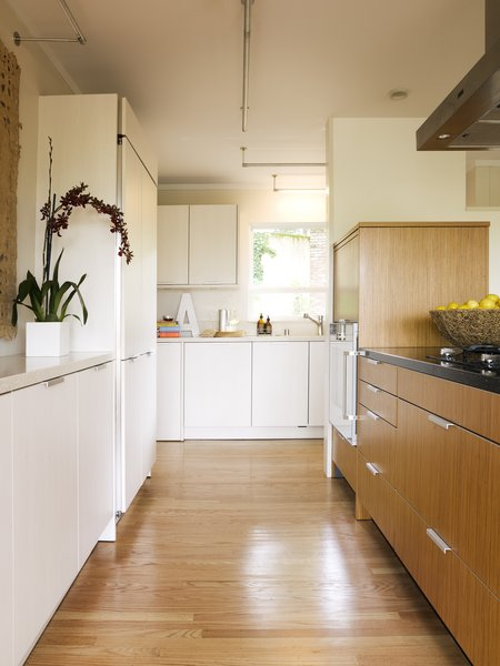 Modern home with kitchen, engineered quartz counter, white cabinet, refrigerator, wall oven, wood cabinet, medium hardwood floor, ceiling lighting, dishwasher, and drop in sink. Work aisle Photo 3 of Sonoma Modern Kitchen
