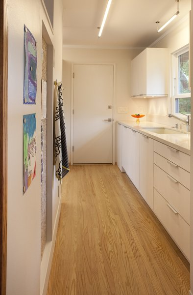 Modern home with kitchen, engineered quartz counter, white cabinet, medium hardwood floor, ceiling lighting, and dishwasher. Photo 4 of Sonoma Modern Kitchen