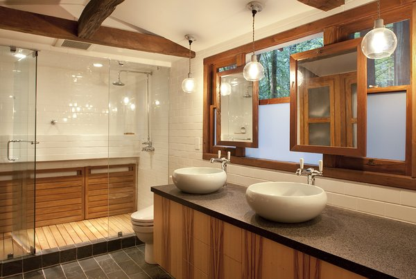 Modern home with bath room, engineered quartz counter, vessel sink, slate floor, enclosed shower, ceiling lighting, and subway tile wall. The Master Bathroom combines mirrors and an opaque film with the existing windows for light and privacy Photo 4 of Creekside Cabin