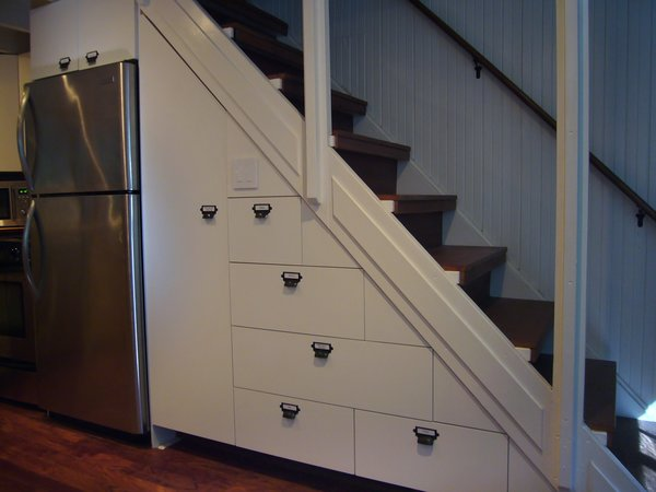 Modern home with engineered quartz counter, slate floor, vessel sink, subway tile wall, storage room, and under stairs storage type. Making the most of under stair storage Photo 5 of Creekside Cabin