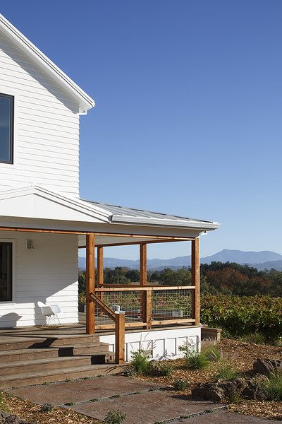 Modern home with outdoor. Wrap around porch  Photo 4 of Modern Vineyard Farmhouse