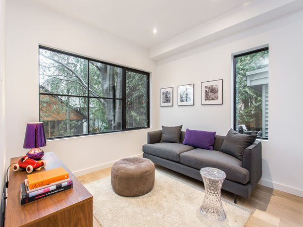 The family room, adjacent to the kitchen, features views on a private garden.  Photo 5 of Manor Road house modern home