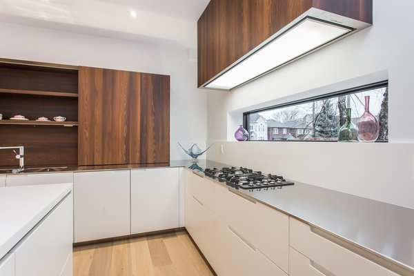 A long window above the countertop provides a nice view to the outside world while cooking.  Photo 7 of Manor Road house modern home