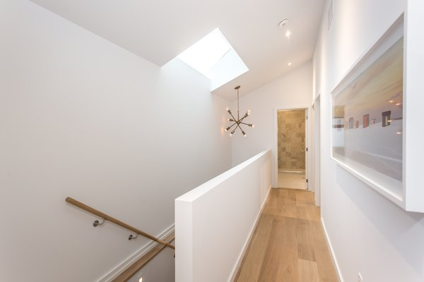 Staircase with skylight. Photo 11 of Manor Road house modern home