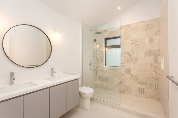 The children's bathroom with Azulej tiles from Mutina and a custom vanity, with Corian top and undermount sinks.  Photo 13 of Manor Road house modern home