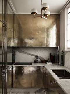 10 Dreamy Parisian Homes - Photo 3 of 10 - Going for Gold<br>A small Parisian kitchen