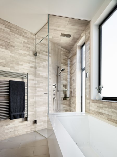 Modern home with bath room, ceramic tile floor, ceramic tile wall, alcove tub, and corner shower. Photo 12 of Telegraph Hill Townhouse