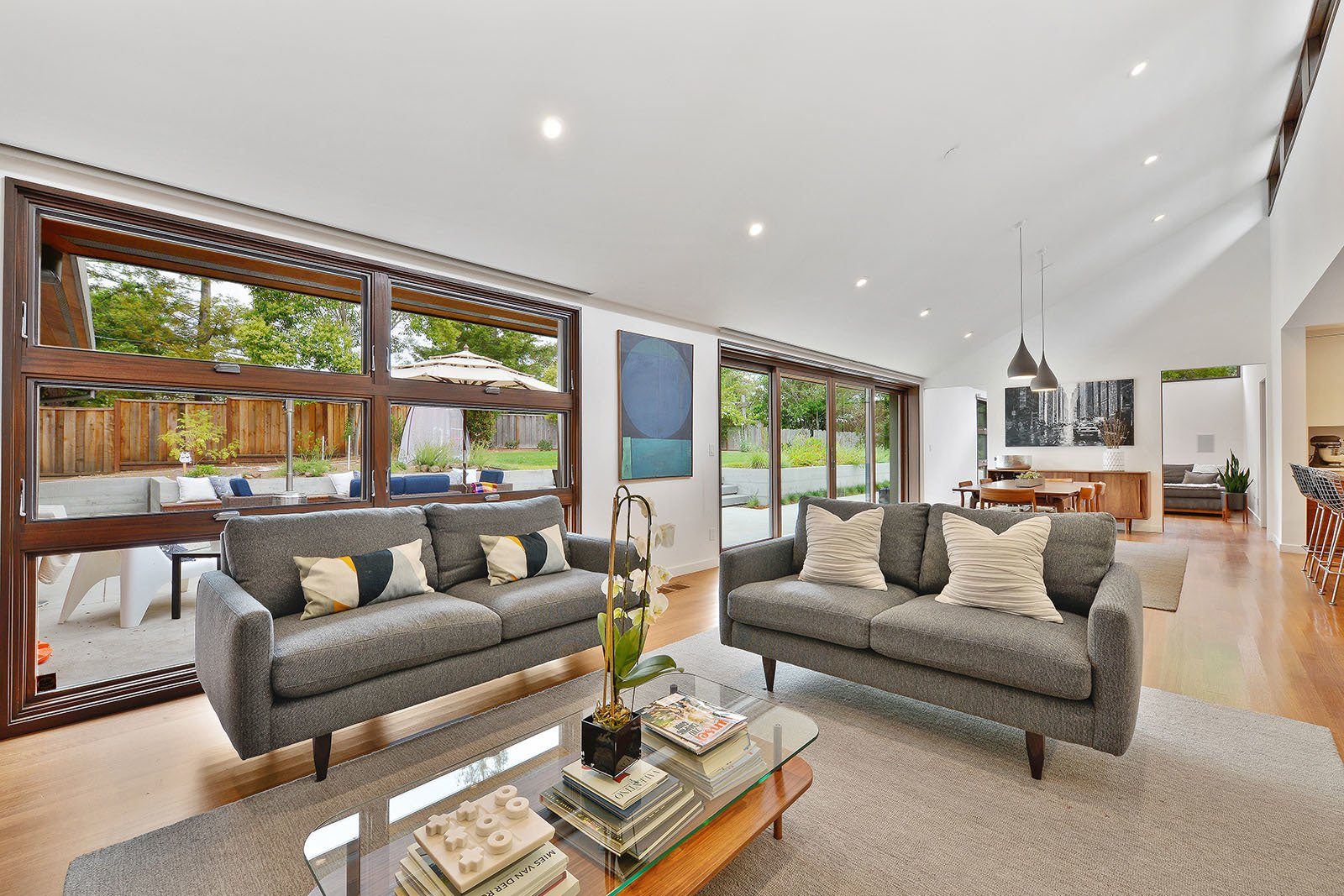 Living room Tagged: Living Room, Coffee Tables, Pendant Lighting, Sofa, Ceiling Lighting, and Medium Hardwood Floor.  Portola Valley by patrick perez/designpad architecture