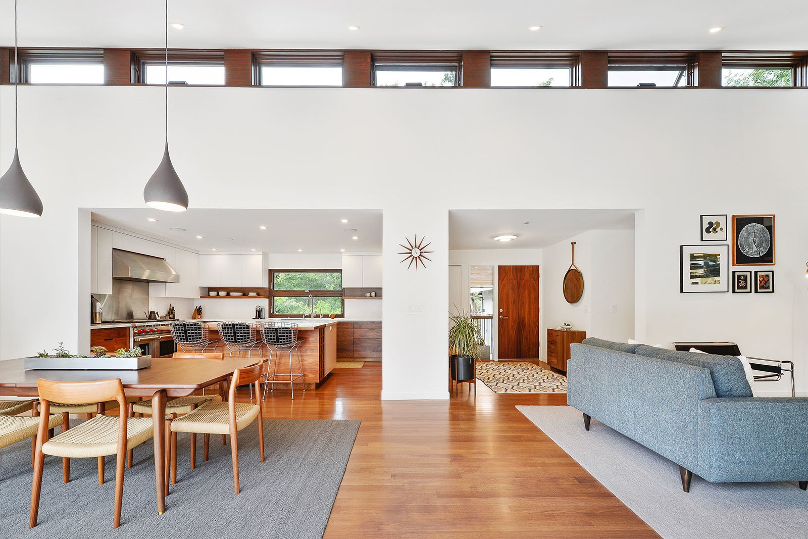 Living room Tagged: Dining Room, Chair, Stools, Table, Lamps, Ceiling Lighting, Pendant Lighting, and Medium Hardwood Floor.  Portola Valley by patrick perez/designpad architecture