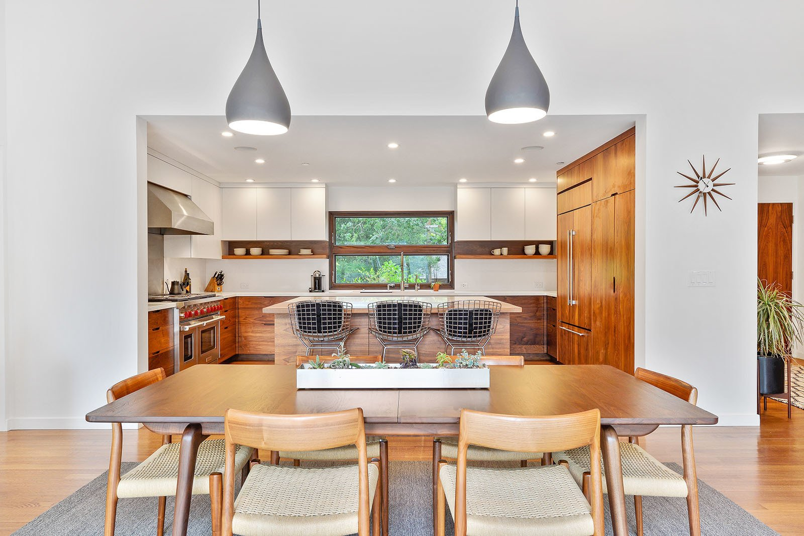Dining room Tagged: Dining Room, Table, Lamps, Chair, Pendant Lighting, Medium Hardwood Floor, and Ceiling Lighting.  Portola Valley by patrick perez/designpad architecture