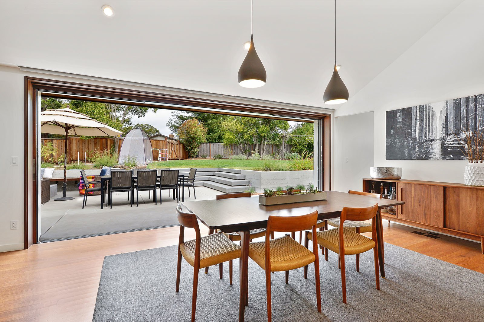 Dining room Tagged: Dining Room, Chair, Pendant Lighting, Table, and Medium Hardwood Floor.  Portola Valley by patrick perez/designpad architecture
