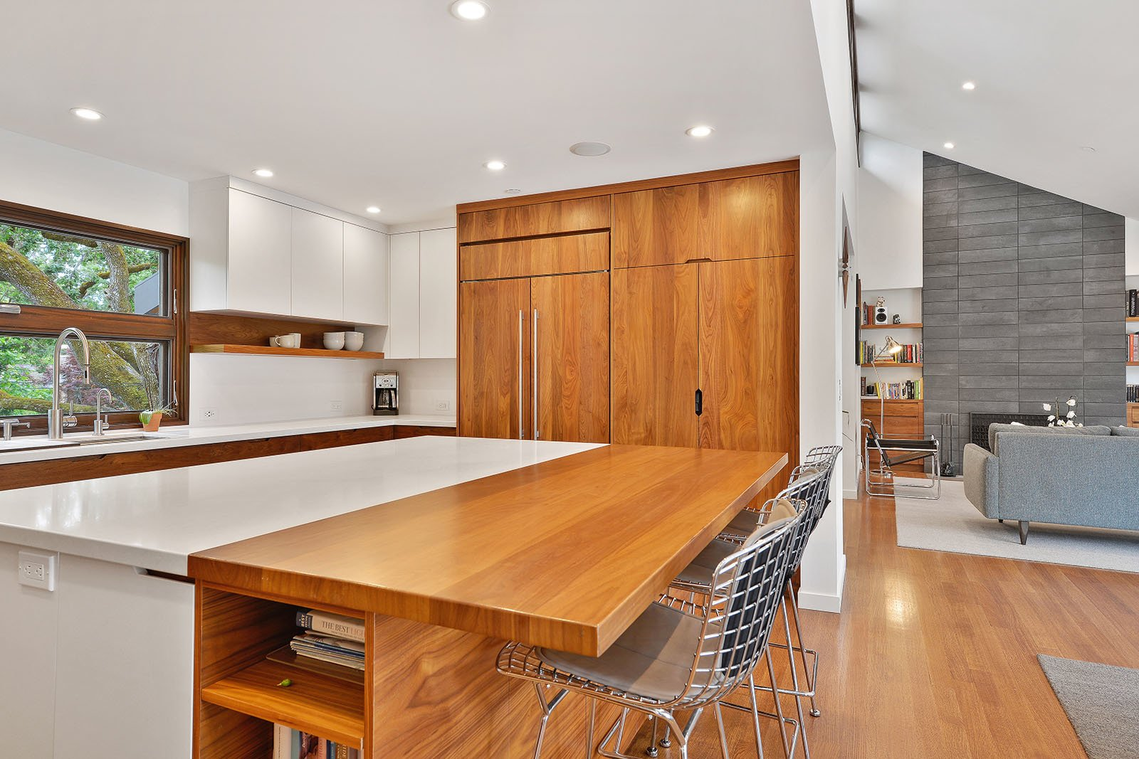 Kitchen Tagged: Kitchen, Wood Cabinet, Engineered Quartz Counter, Stone Slab Backsplashe, Medium Hardwood Floor, Ceiling Lighting, and Refrigerator.  Portola Valley by patrick perez/designpad architecture
