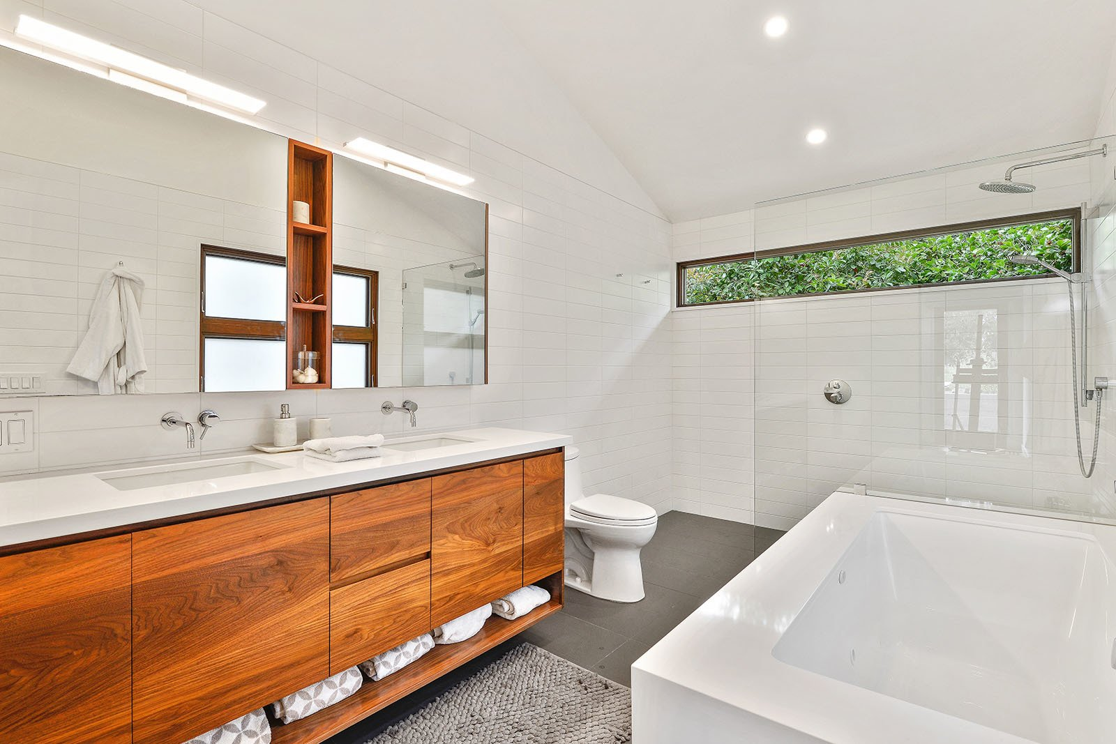 Bath Tagged: Bath Room, Engineered Quartz Counter, Undermount Sink, Ceramic Tile Floor, Tile Counter, Undermount Tub, Open Shower, Subway Tile Wall, Ceiling Lighting, Ceramic Tile Wall, and One Piece Toilet.  Portola Valley by patrick perez/designpad architecture