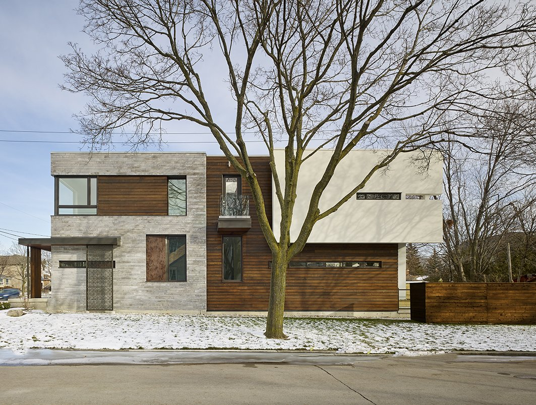 West Elevation and Light Control with windows shape Garden Void House by Alva Roy