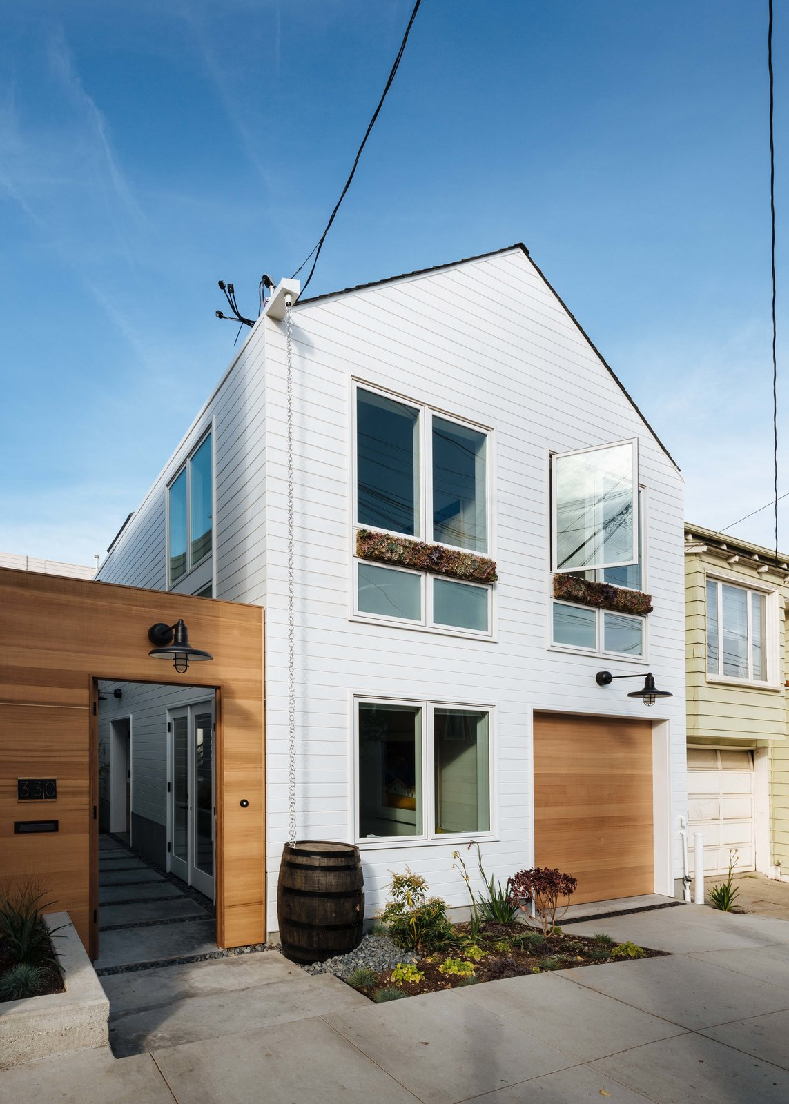 Space-Efficient Renovation in San Francisco, California Tagged: Outdoor, Gardens, Walkways, Front Yard, and Concrete Patio, Porch, Deck.  Space-Efficient San Francisco Renovation by Red Dot Studio