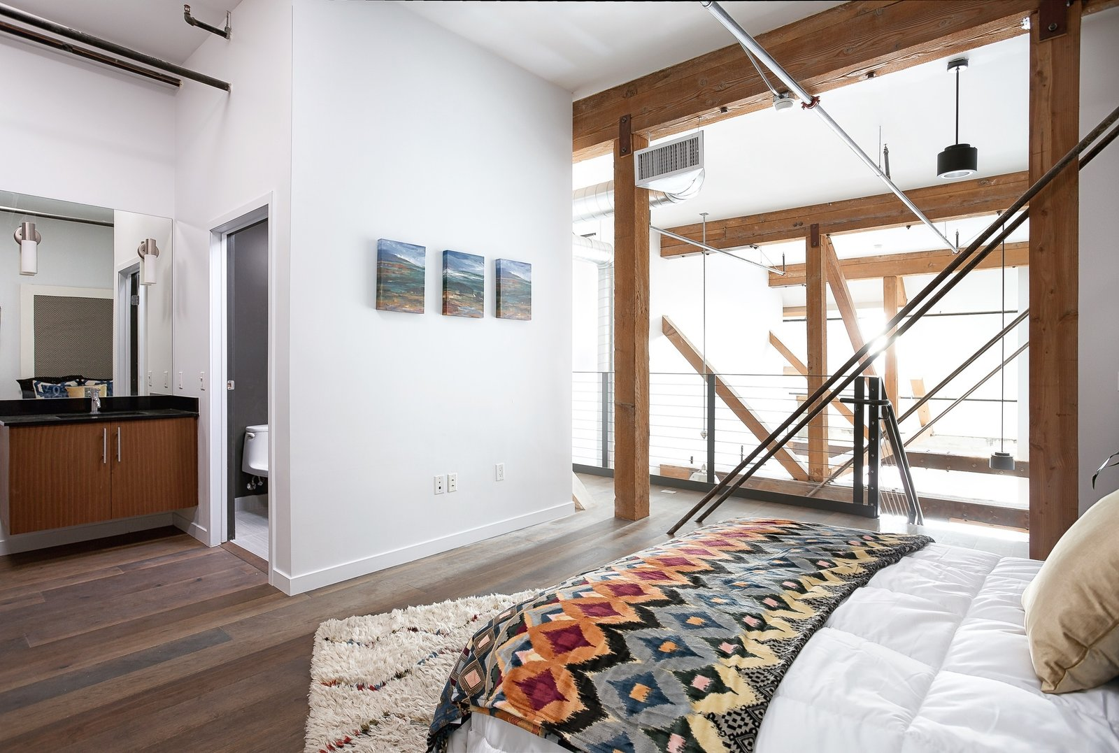 DTLA arts district loft. Architectural interest from the beams in old warehouse.   Photo 3 of 11 in Make Your Space Look Bigger: 10 Lofted Bedrooms from Recent work