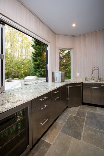 The stainless steel cabinets and appliances in this outdoor kitchen are customized for outdoor use. Because it is an outdoor kitchen, all plumbing is designed to be drained and winterized. Photo 7 of Outdoor Kitchen and Patio modern home