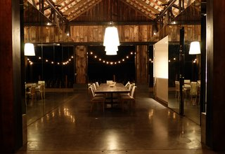"""13 Brilliant Barn Conversions That Merge Past and Present - Photo 7 of 13 - This adaptive reuse project called for the relocation and transformation an empty barn for contemporary art collectors and philanthropists Cindy and Howard Rachofsky. They were taken with the barn's history and wanted to use the structure as an entertainment space and gym. <span style=""""color: rgb(204, 204, 204); font-size: 13px;"""">Matthew Millman</span>"""