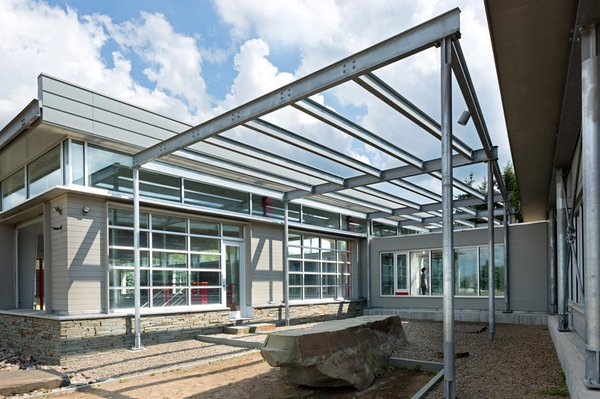 inside the courtyard Photo 2 of Covered Tennis Court complex modern home