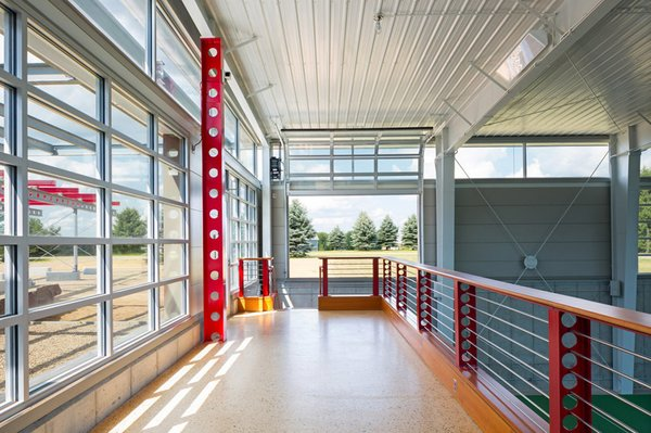 interior of Tennis Court from mezzanine Photo 4 of Covered Tennis Court complex modern home