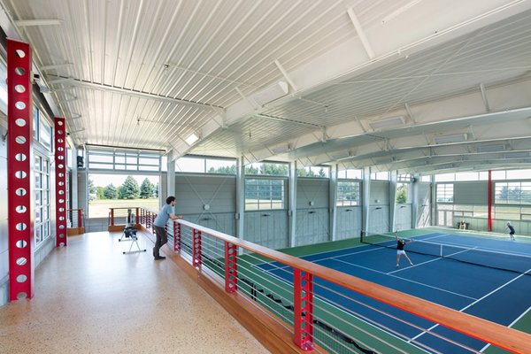 interior of Tennis Court from mezzanine Photo 5 of Covered Tennis Court complex modern home