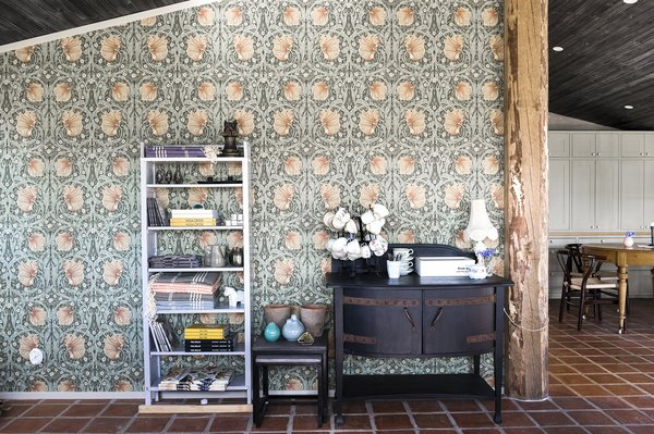 An old log makes for a great divider. Beautiful wallpaper from William Morris