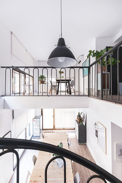 "The space is divided into two levels, re-opened in this office renovation.  Photo 8 of ""La Agencia"" a new brand workspace plenty of design and inspiration modern home"