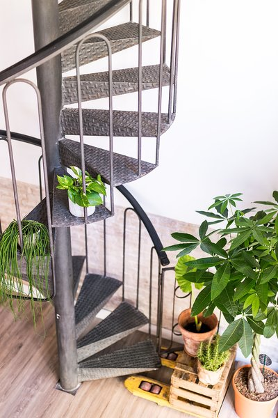 "A brand new and beautiful spiral staircase join the two levels in this office. Photo 10 of ""La Agencia"" a new brand workspace plenty of design and inspiration modern home"