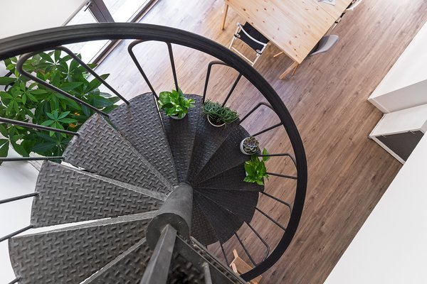 "A brand new and beautiful spiral staircase join the two levels in this office. Photo 11 of ""La Agencia"" a new brand workspace plenty of design and inspiration modern home"