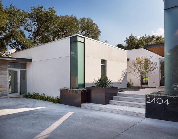 Custom steel corner windows, steel planters, limestone stairs. Photo 5 of Vance Lane Residence modern home