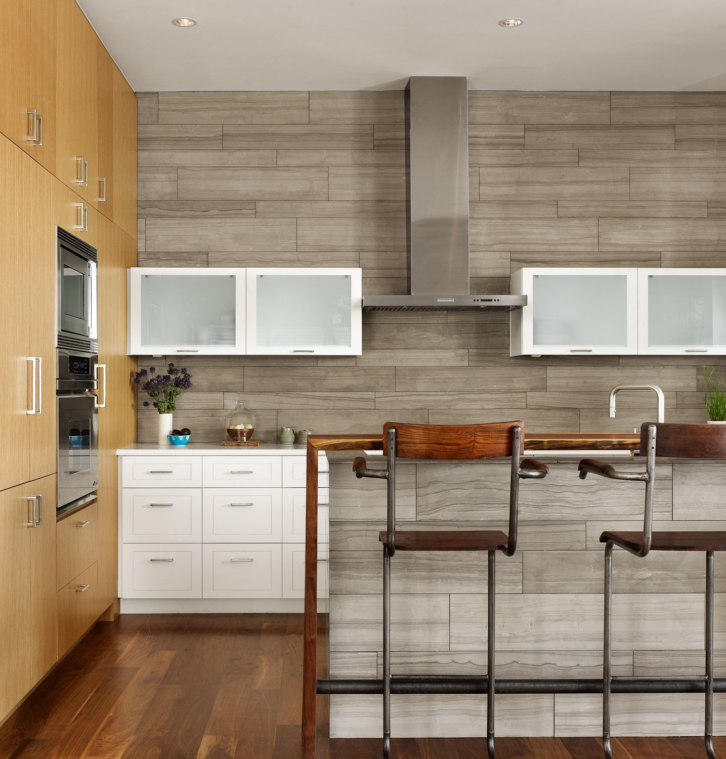 The Kitchen was designed with painted and natural wood finished cabinets.