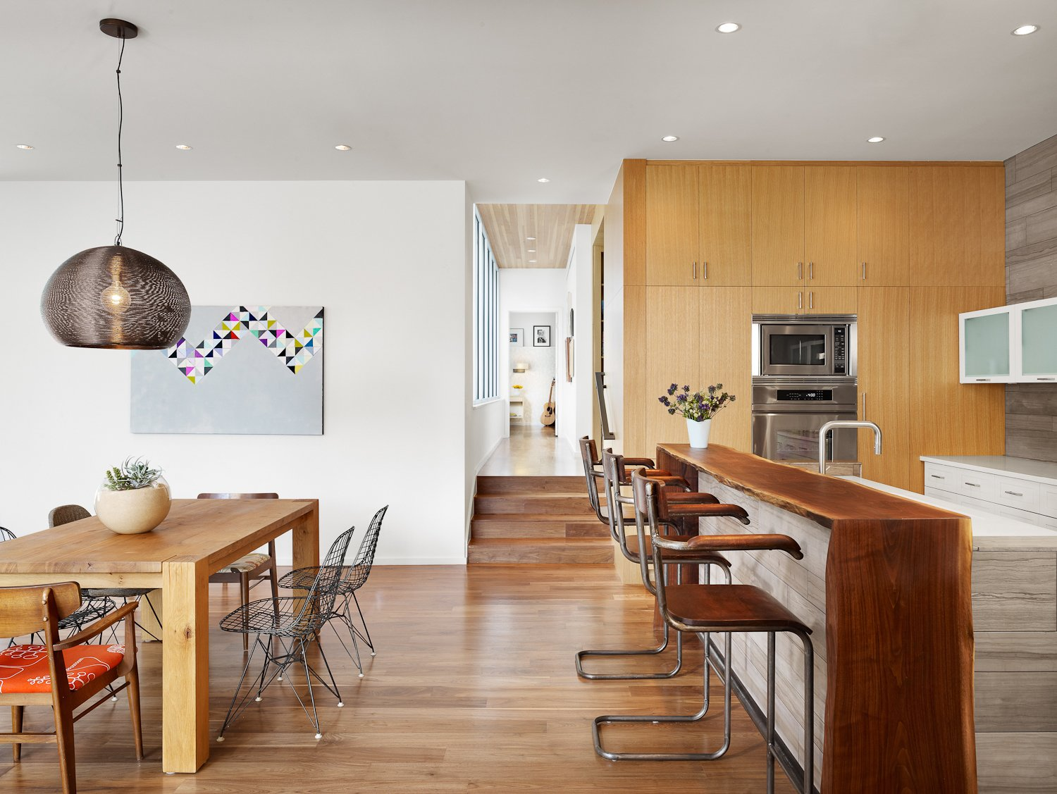 Dining and Kitchen with view towards Master Bedroom.  Walnut slab bar with live edge.  Vance Lane Residence by Jamie Chioco