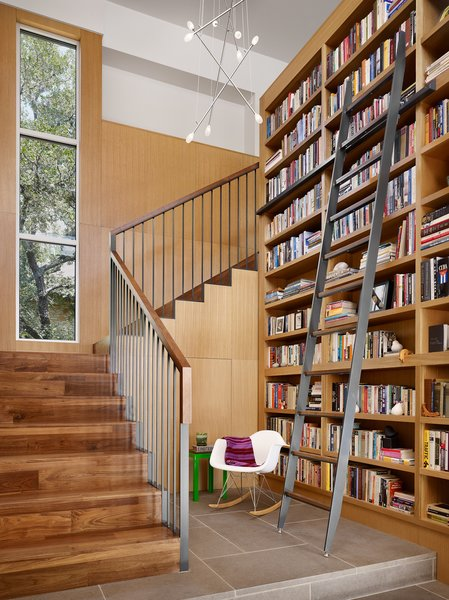 Stair and Library reading nook and custom steel library ladder. Photo 7 of Vance Lane Residence modern home
