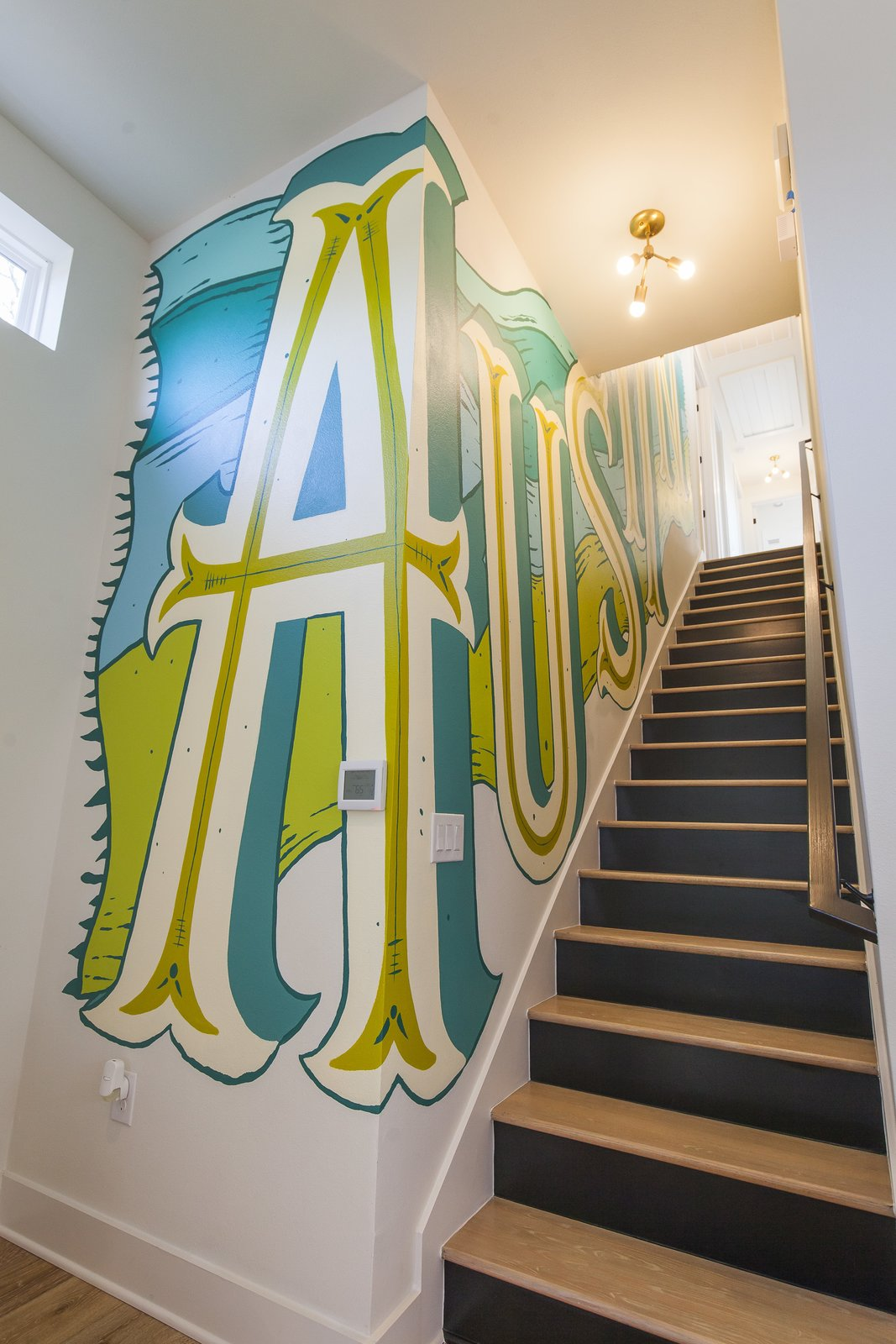 Unit A - Stairwell - This is the custom mural we had designed for the staircase to keep things interesting but also invite some good ole' Austin charm into the house.