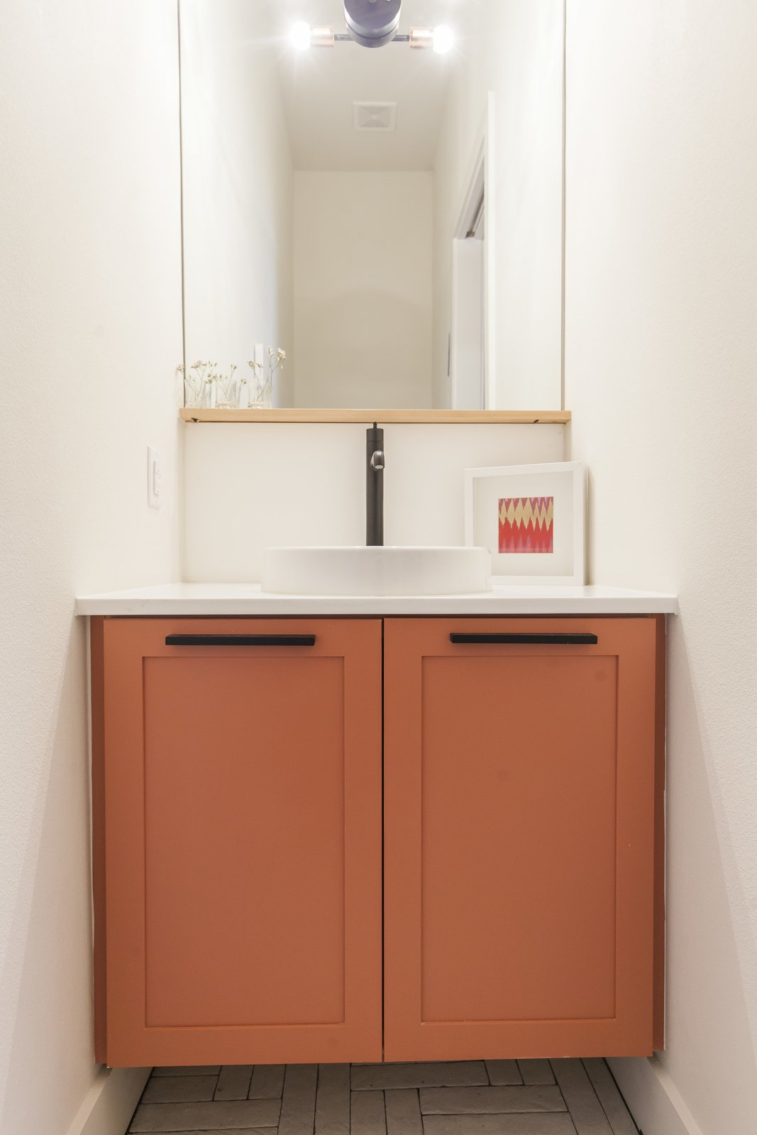 My favorite - Unit A powder room.  Simple and unique.