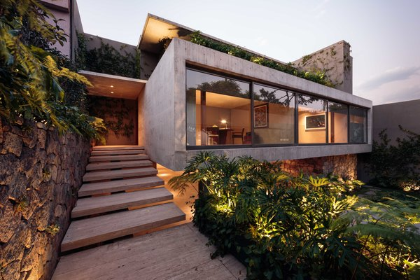 Modern home with outdoor, shrubs, front yard, and landscape lighting. CAUCASO Photo 2 of Caucaso